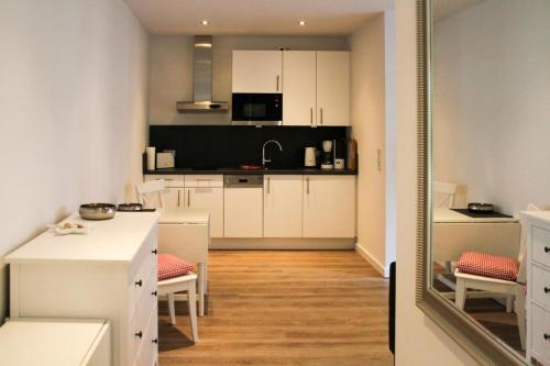 Küche/Küchenzeile in der Unterkunft Haus an den Salzwiesen - Wohnung Heringsmöwe
