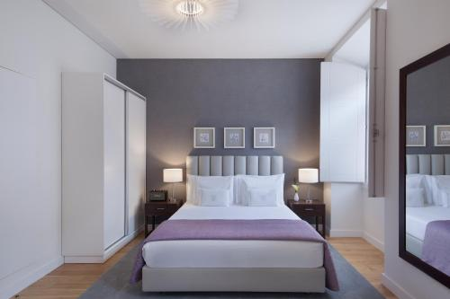 A bed or beds in a room at Altis Prata Hotel