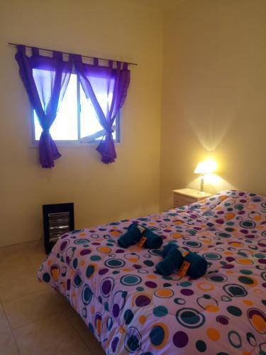 Een bed of bedden in een kamer bij Ensueño Cordillerano