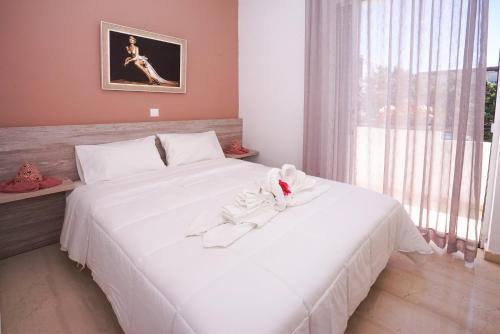 Ένα ή περισσότερα κρεβάτια σε δωμάτιο στο Sunset Apartments