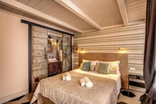 A bed or beds in a room at DeCharme apartment with terrace in Monti