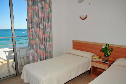 A bed or beds in a room at S'Arenal Apartments