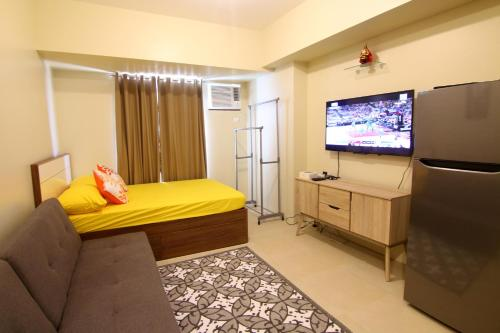 A bed or beds in a room at Avida Towers Riala, IT Park, Cebu city