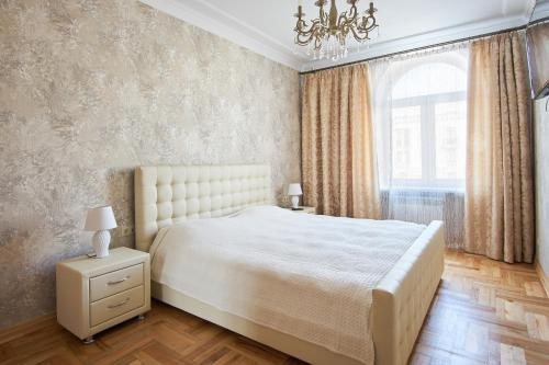 A bed or beds in a room at Studiominsk 9 Apartments