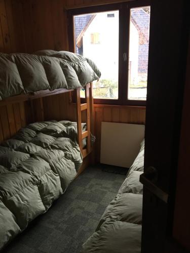 Una cama o camas cuchetas en una habitación  de Merihue