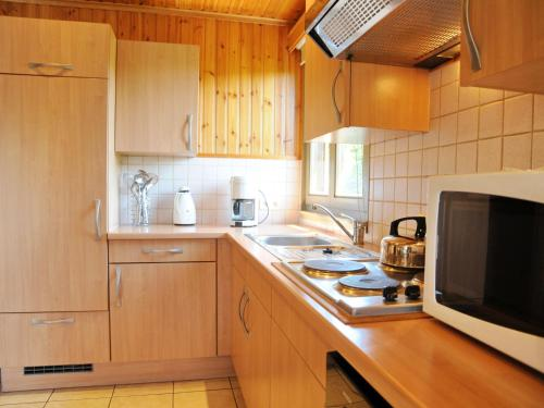 A kitchen or kitchenette at Chalet Pluton 4