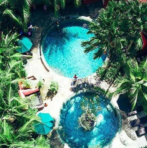 A view of the pool at PinkCoco Bali or nearby
