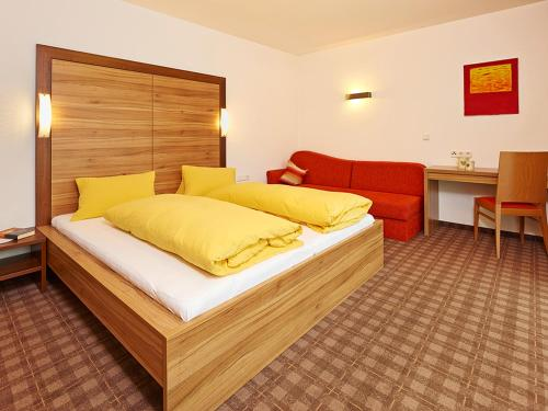 A bed or beds in a room at Apart Mado