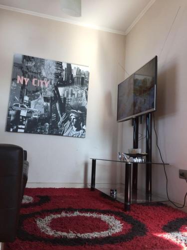 Una televisión o centro de entretenimiento en Arriendo por día