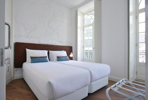 A bed or beds in a room at Spot Apartments Casa Januario