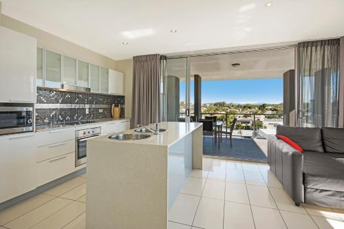 A kitchen or kitchenette at The Chermside Apartments