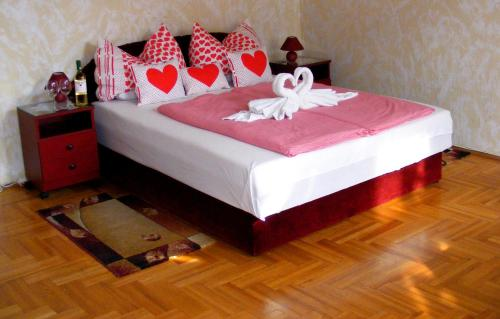 A bed or beds in a room at Firstapartments Inn City Center