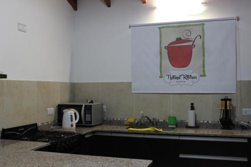 Кухня или мини-кухня в Casa Crisolito