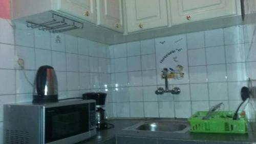 A kitchen or kitchenette at Complexe Maranatha
