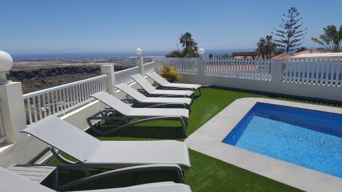 Het zwembad bij of vlak bij Holiday Home Villa Fonzie Montaña La Data
