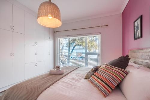 A bed or beds in a room at Ocean View Beach House