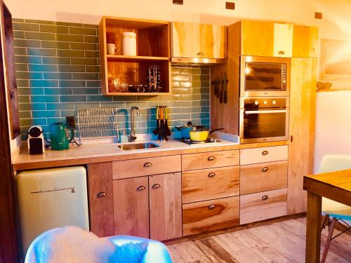 A kitchen or kitchenette at DT Loft