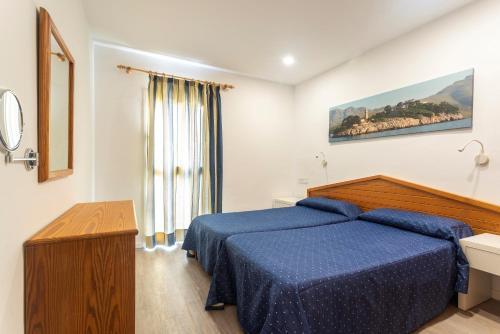 A bed or beds in a room at Apartamentos Massol