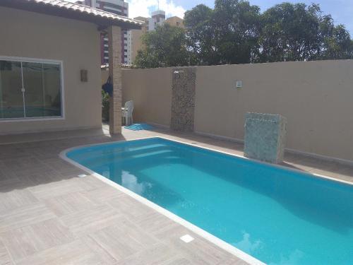 The swimming pool at or near Aracaju Atalaia Beach House