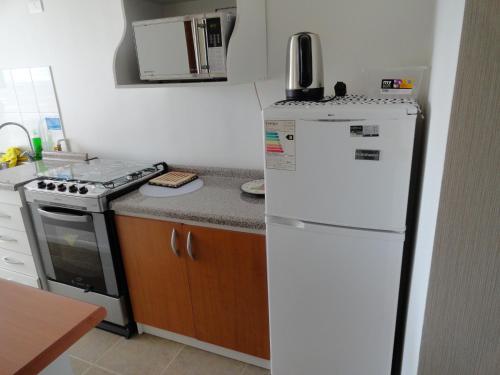 Una cocina o zona de cocina en Departamento Gimar