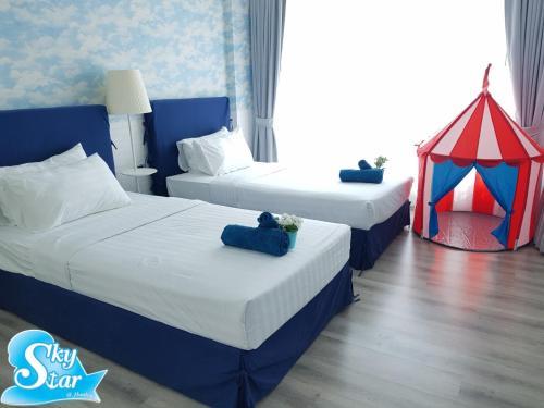 เตียงในห้องที่ Santora Hua Hin by Skystar