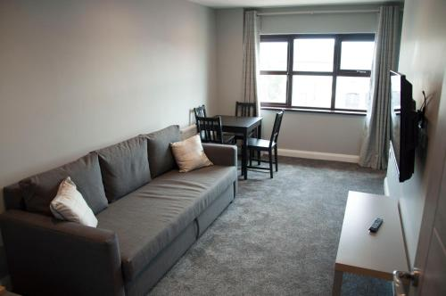 A seating area at The Square Guest Apartment