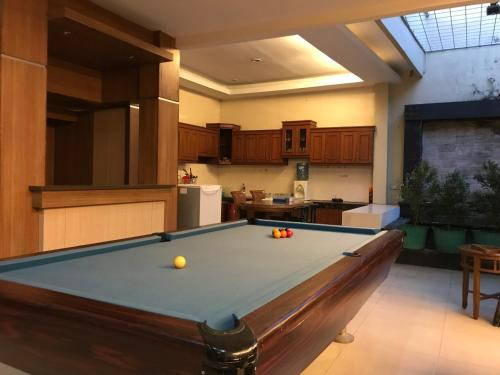A pool table at U-Nice Residence,15 beds ENTIRE HOUSE,city central Jogja