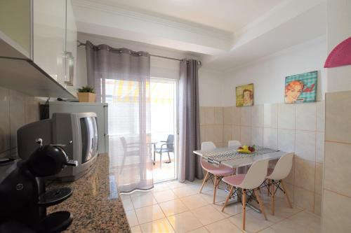 A kitchen or kitchenette at Beach Design Apartment