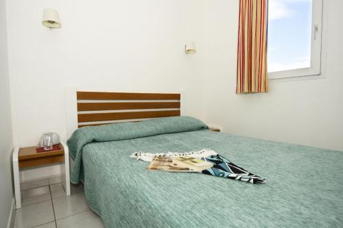 Кровать или кровати в номере Résidence Odalys Primavéra