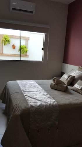 A bed or beds in a room at Casa Temporada em Bonito