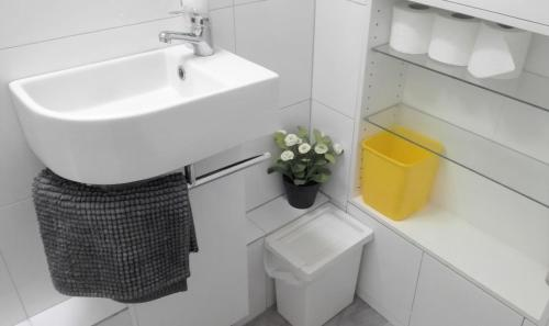 A bathroom at Stylish studio with mezzanine 5 min to the tube