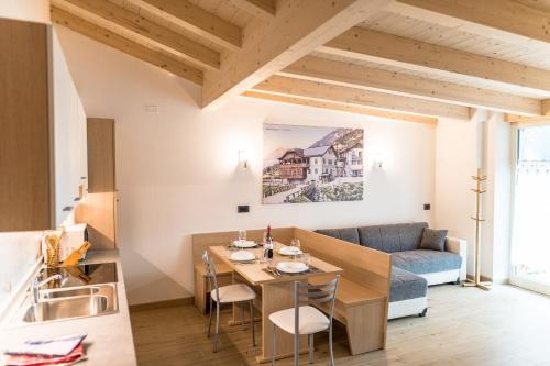 Ein Restaurant oder anderes Speiselokal in der Unterkunft Attico Elbetina