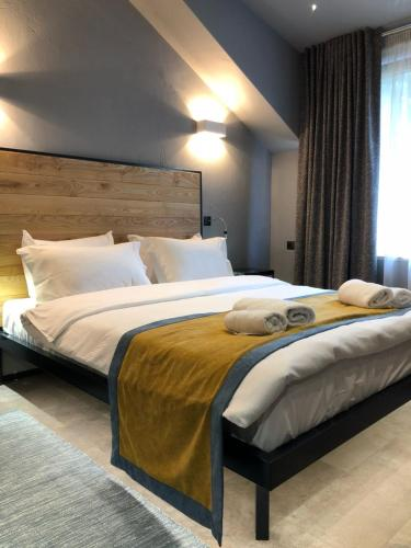 A bed or beds in a room at Plai Hotel