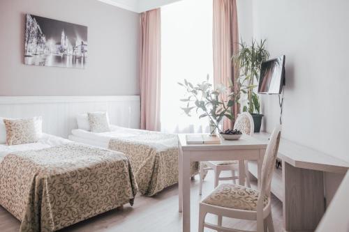 Letto o letti in una camera di Apartamenty Bonerowska 5