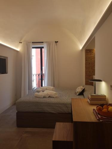 A bed or beds in a room at i 26 Gradini Capri