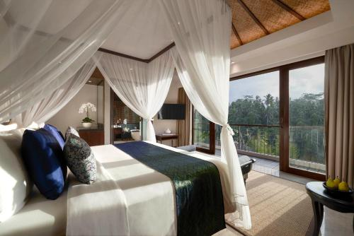 A bed or beds in a room at Samsara Ubud