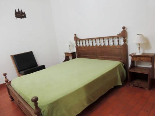 Una cama o camas en una habitación de Chalet Del Bosque