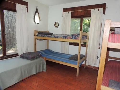 Una cama o camas cuchetas en una habitación  de Chalet Del Bosque