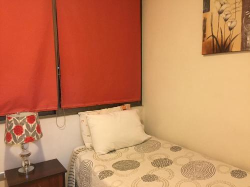 Cama o camas de una habitación en Apartamentos en Santiago Centro
