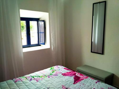 A bed or beds in a room at Casa da Serra
