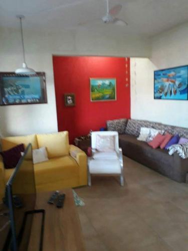 Zona de estar de Casa 16 Pessoas 20m do mar 006