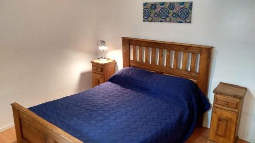 Una cama o camas en una habitación de Alojamiento M&F - familiar