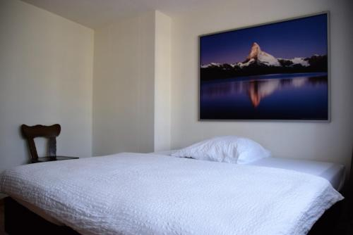 Ein Bett oder Betten in einem Zimmer der Unterkunft Hotel-T8