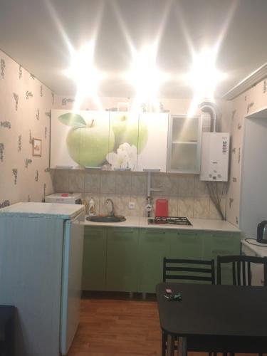 A kitchen or kitchenette at Кварира