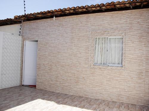 The facade or entrance of Casa Aconchegante