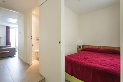 A bed or beds in a room at MULTIRESIDENCE L'ELYSEE Paris