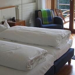 Ein Bett oder Betten in einem Zimmer der Unterkunft Hotel Oberschwaebischer Hof