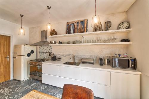 A kitchen or kitchenette at Marie Paradis Apartment