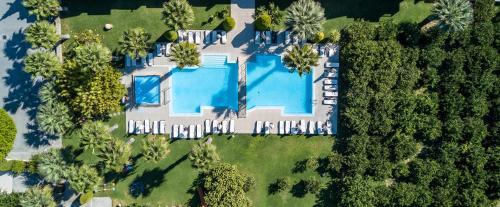 Uitzicht op het zwembad bij Stavros Melathron Studios of in de buurt