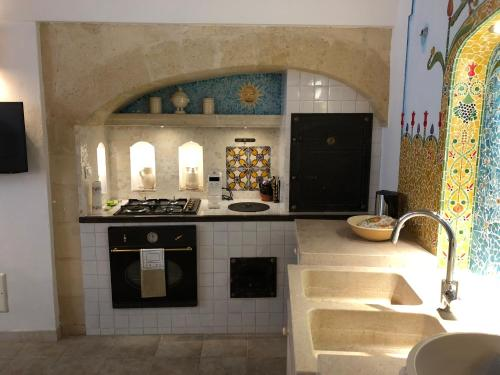 """Cucina o angolo cottura di """"Il Mosaico"""" Suite Apartment - Grottaglie"""